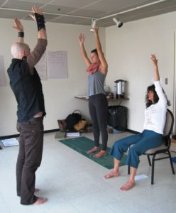 A volunteer practices teaching at Yoga Outreach's trauma-informed yoga training