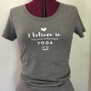 "grew crew neck with the words ""I believe in trauma-informed yoga"" on it"