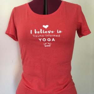 """red crew neck with the words """"I believe in trauma-informed yoga"""" on it"""