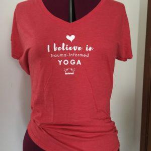 Red v neck tee with yoga outreach logo