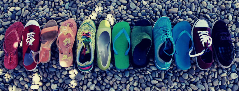 a row of several different shoes side by side