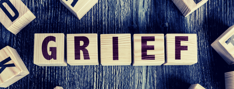 A set of scrabble tiles spelling out the word Grief