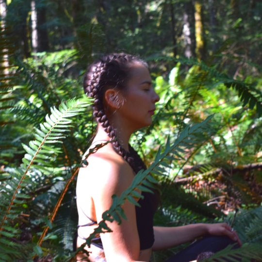 First Nations Yoga Teacher Ivy Richardson sits in meditation in the forests of central Vancouver Island.